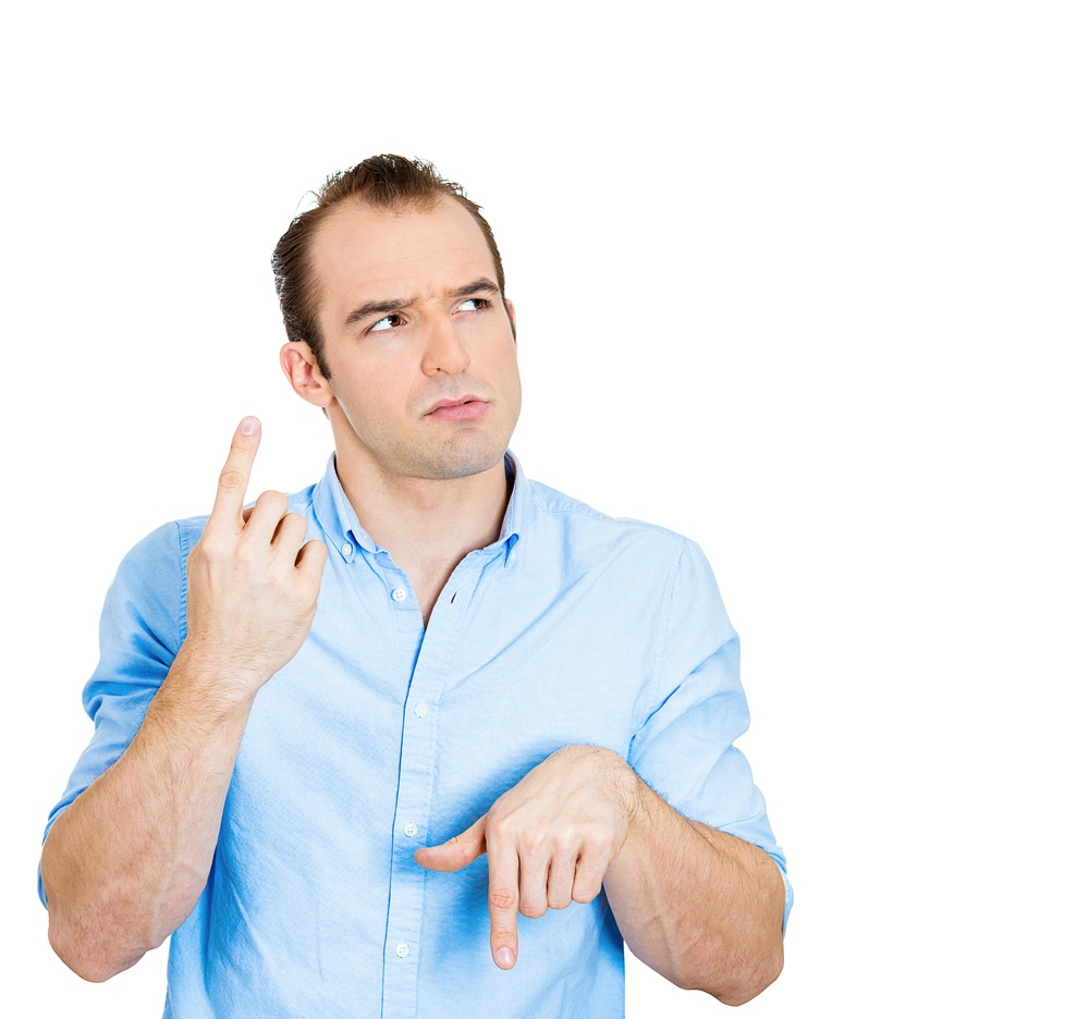 Closeup portrait confused young business man pointing in two different directions, not sure which way to go life, hesitant to make decision isolate white background. Emotion, facial expression feeling.jpeg