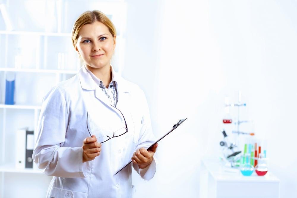Scientist in uniform doing tests in laboratory.jpeg